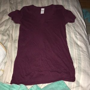 Maroon size medium shirt from pink.